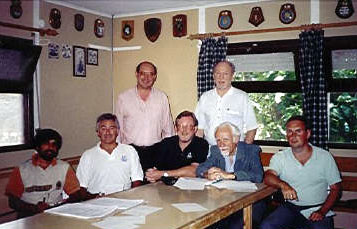 The photograph shows the founding committee of the Cricket Association of Portugal at their inaugural meeting on 19 June 1994. From left to right: Akbar Salyad, John Simonson, Malcolm Peatfield, Mark Hanmer, Peter Eckersley, Peter Madison (Chairman) and Nicholas Heaton.